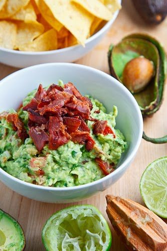 Bacon Guacamole -  Ingredients:  4 strips of bacon  2 large avocados, mashed  1 lime, juice  1 jalapeno pepper, finely diced  1 medium tomato, seeded and finely diced  1/4 cup red onion, finely diced  1 tablespoon cilantro, chopped  1/2 teaspoon cumin, toasted and ground  salt and pepper to taste