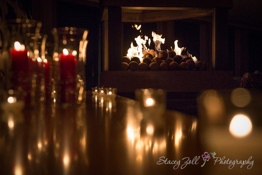 Reception ambiance / fireplace / candles / evening wedding | Kansas Wedding Photographer | Stacey Zoll Photography Manhattan, KS | staceyzphotography.com