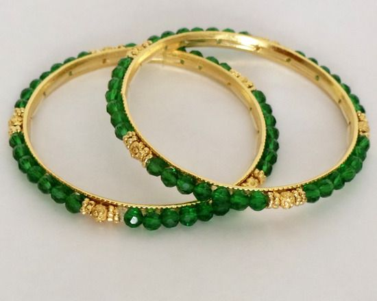Gold plated bangles surrounded by green round glass beads with gold plated flower spacers  http://www.craftandjewel.com/servlet/the-1320/Gold-plated-bangles-surrounded/Detail