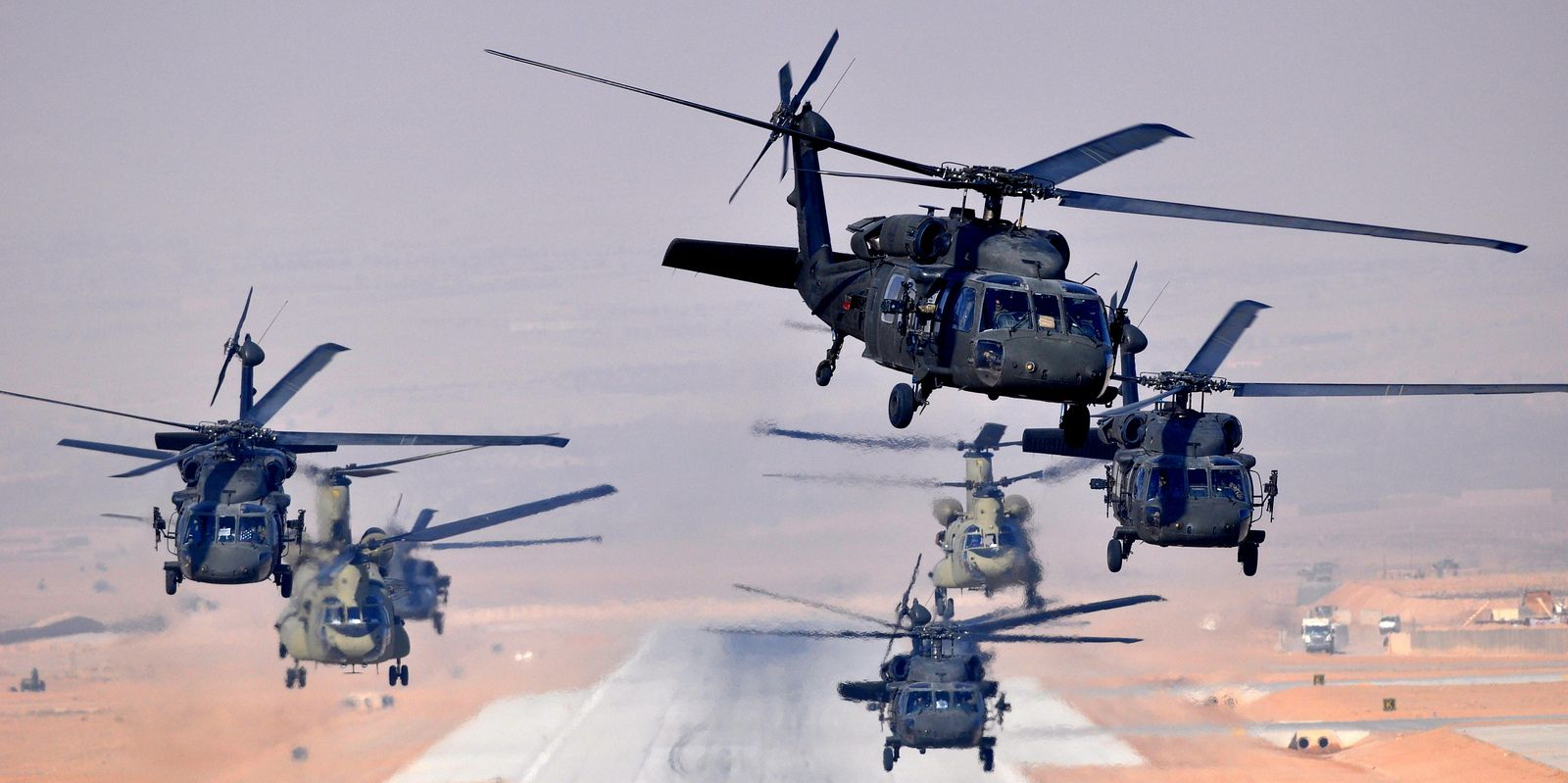 Six UH-60L and two CH-47F Chinooks, assigned to Task Force Brawler, 4th Battalion, 3rd Aviation Regiment