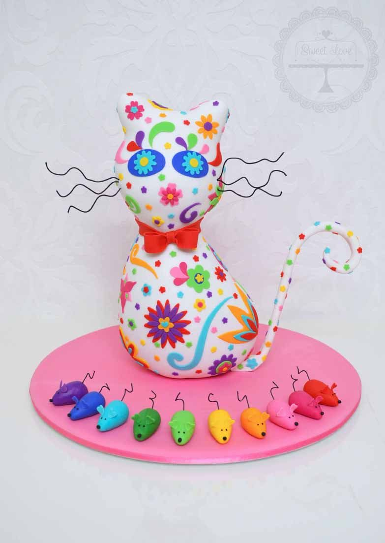 Cute and very colourful pussy cat cake.