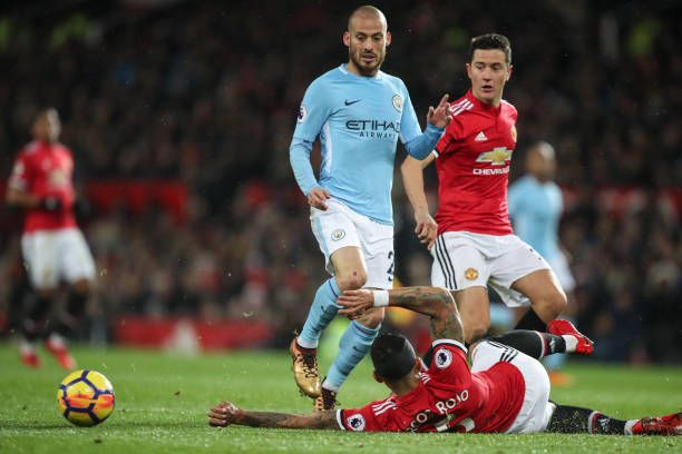 David Silva Of Manchester City And Marcos Rojo Of