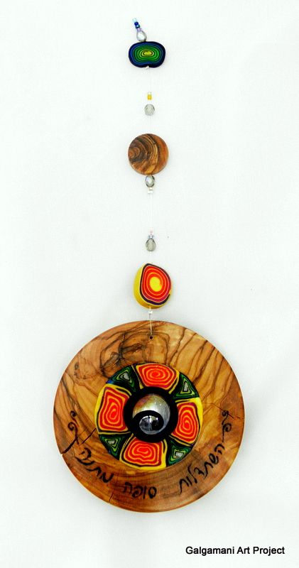 A mobile made from very old piece of olive wood combined with fimo
