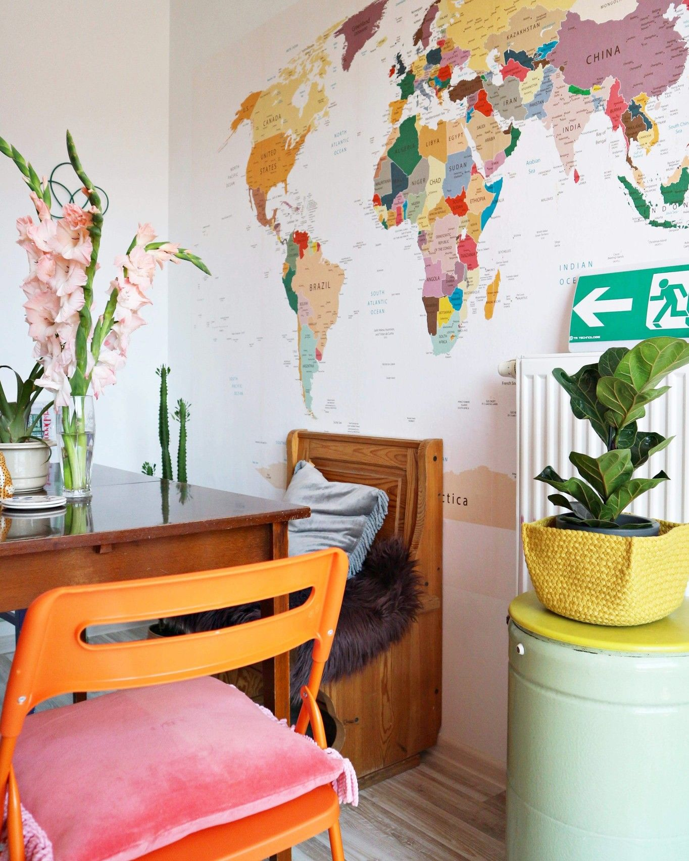 My colorful dining room with a world map on the wall and lots of