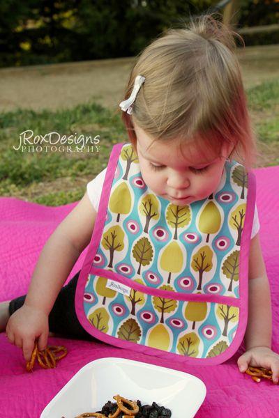 Craftaholics Anonymous®   Simple Pocket Bib Pattern and Tutorial - Free pattern and tutorial. One of the easiest tutorials I've seen using laminated fabric.
