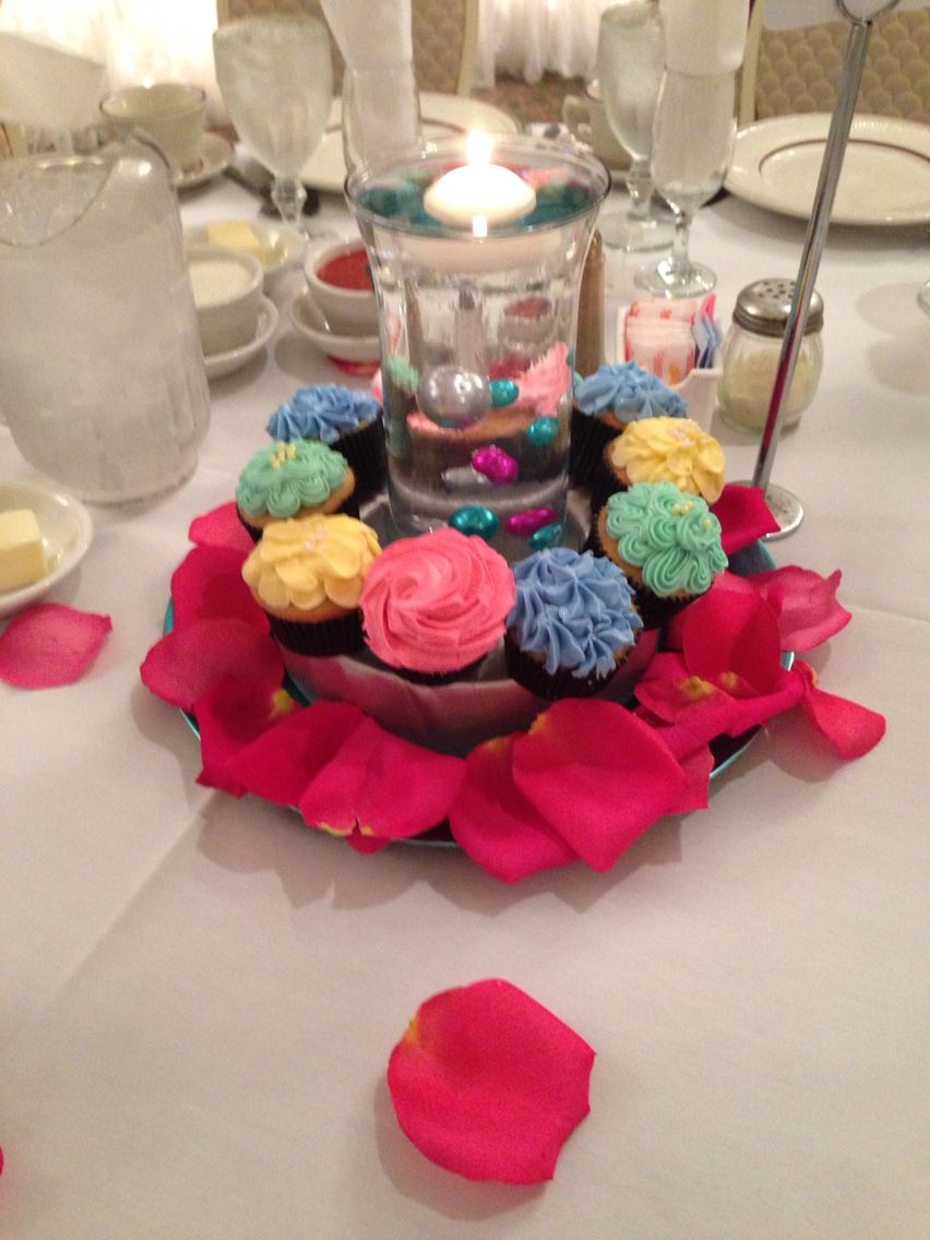 Cupcake centerpiece with flower cupcakes, clear water beads ...
