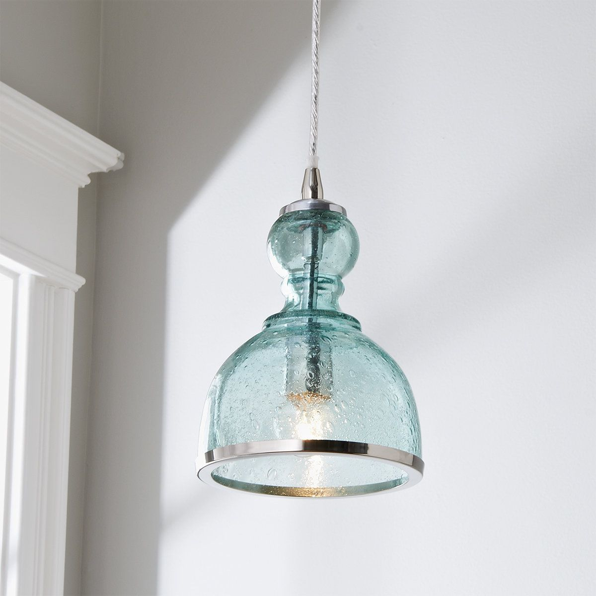 Our Colored Seeded Glass Pendant adds a fresh, clean look to your kitchen or dining area. Select from modern color combinations and sizes to customize your look or group together for a major statement! Clean with dry cloth only.