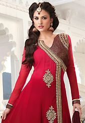 Ultimate collection of embroidered suits with fabulous style. The dazzling shaded red faux georgette churidar suit have amazing embroidery patch work is done with resham, zari and stone work. Beautiful embroidery work on kameez is stunning. The entire ensemble makes an excellent wear. Contrasting maroon santoon churidar and maroon chiffon dupatta is available with this suit. Slight Color variations are possible due to differing screen and photograph resolutions.
