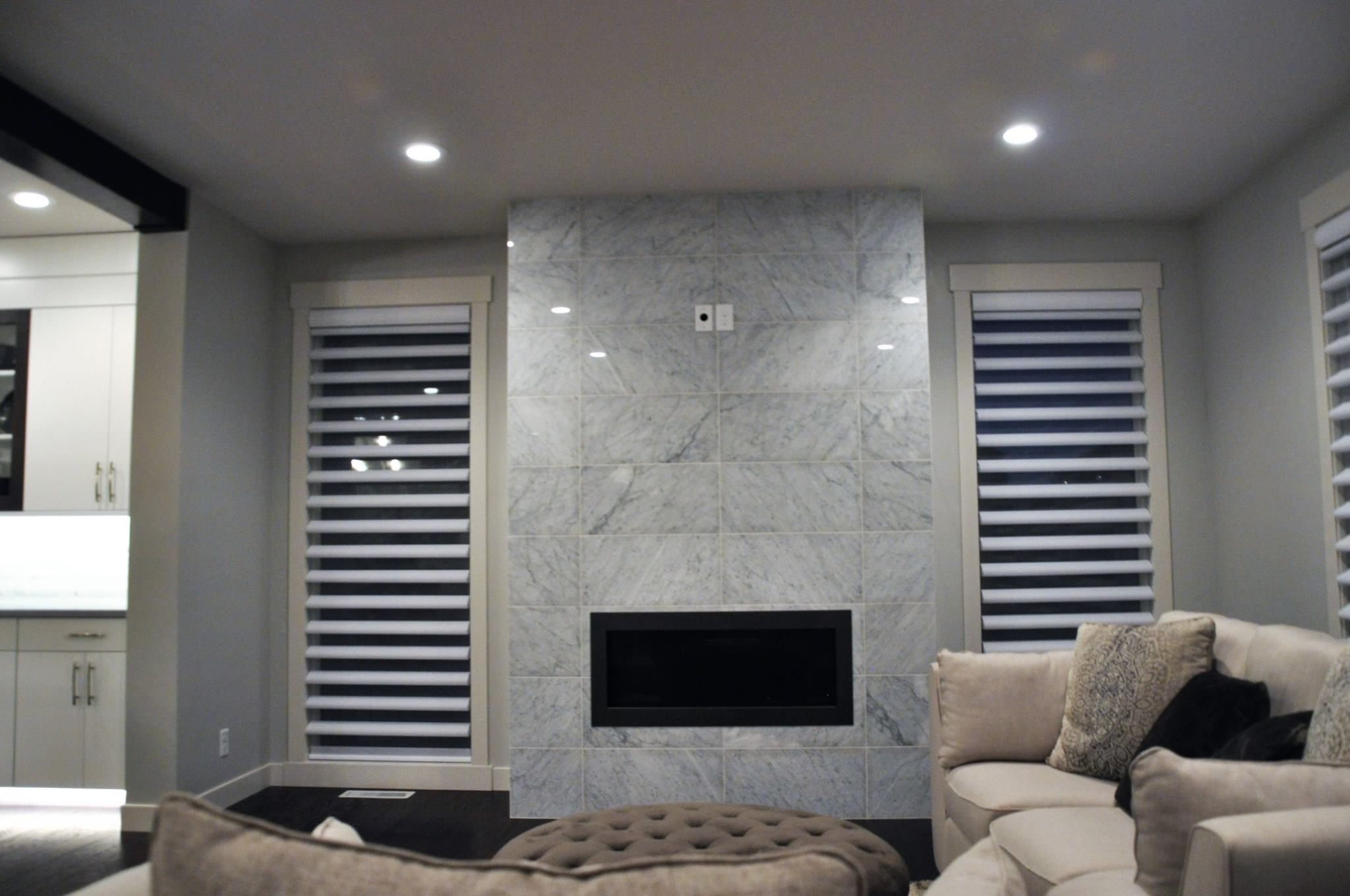 Beautiful floor to ceiling marble fireplace ready to warm