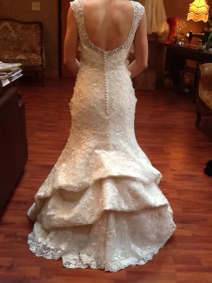 Waterfall Bustle With The Lining On Mermaid Style Wedding Gown