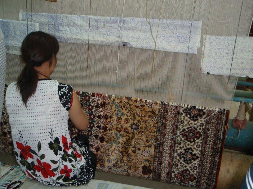 Chinese woman making carpets