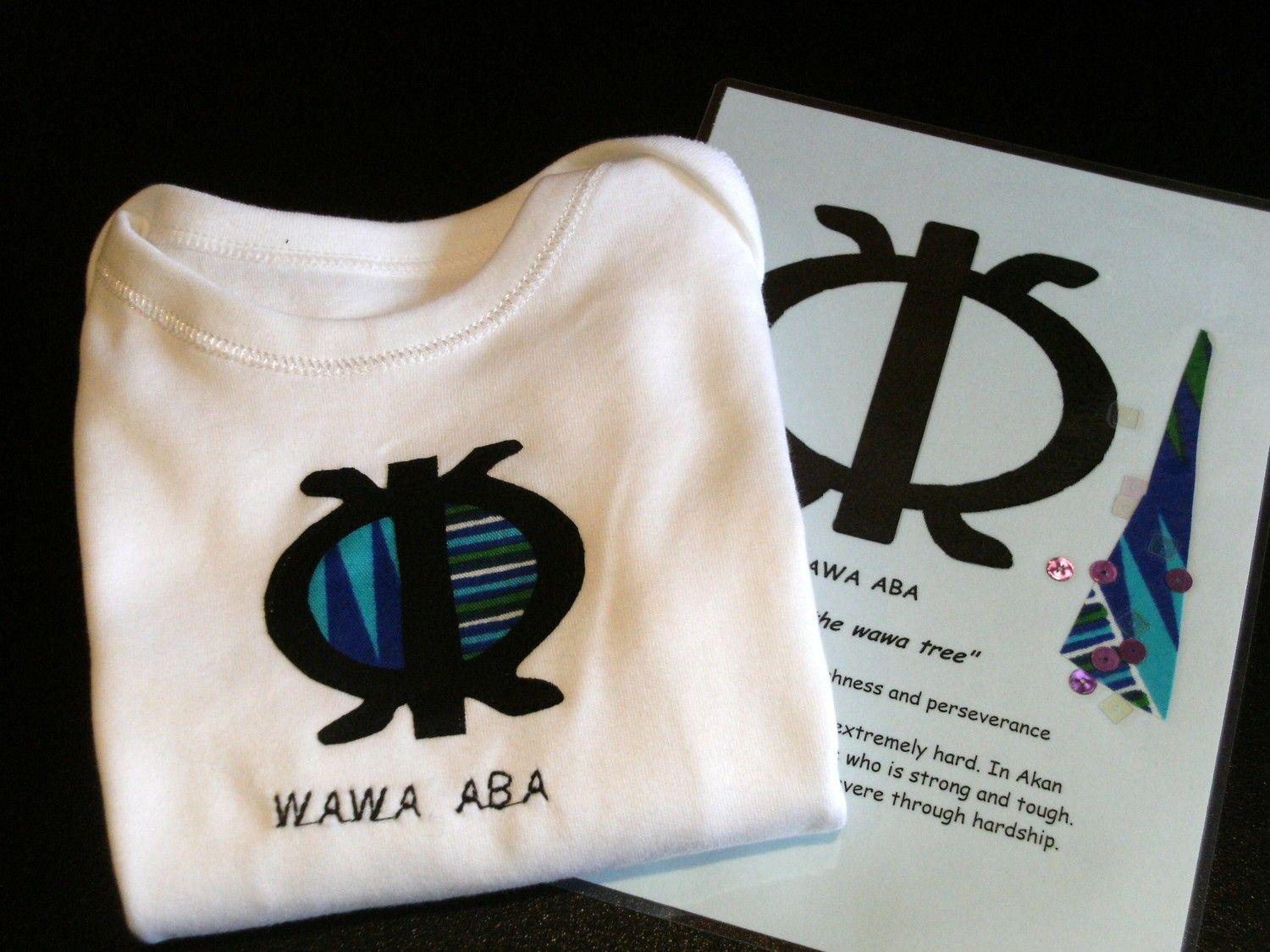 Baby vest with Adinkra symbol appliqué, embroidered name and matching card, 9-12 months. $12.80, via Etsy.