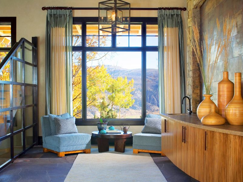 Ralph Lauren chairs topped with a Glant fabric flank a Helene Aumont coffee table  INTERIOR DESIGN by Worth Interiors PHOTO by Emily Minton Redfield MORE AT http://www.mountainliving.com/article/western-elegance
