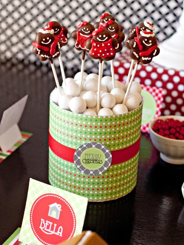 Gingerbread Cake Pops: cut out with a mini gingerbread man cookie cutter; dip the entire cutout in melted chocolate, then decorate with red and white icing.