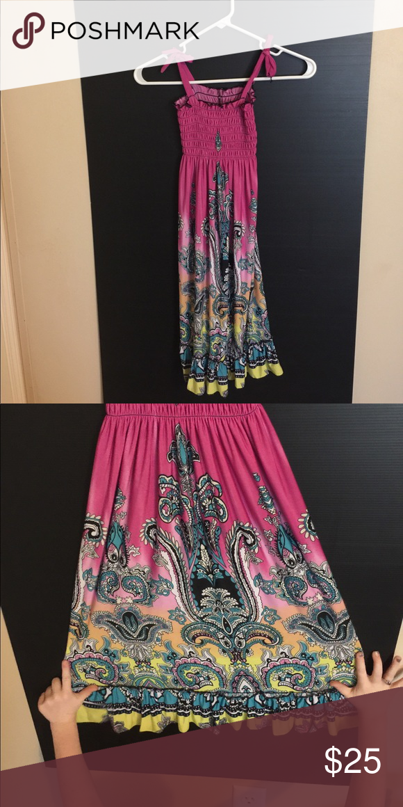 Pretty multi colored dress for summer. Very pretty Multi colored sun dress very beautiful size fits 7-10. Very versatile great addition to any closet. Make me an offer or bundle for a discount. Rural King Dresses Casual