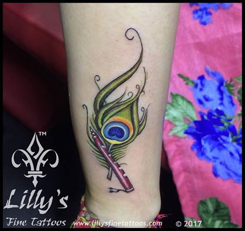 033233208 Tattoo by -#DeepakVetal at Lilly'sFineTattoo www.lillysfinetattoo.com # peacock #feather #with #flute #tattoo #awesome #craze #design #inkforlife  #creativity ...