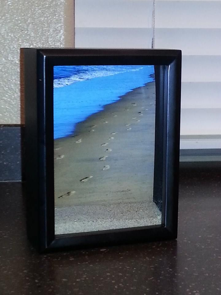 take a picture of your footprints in the sand from one of your walks ...