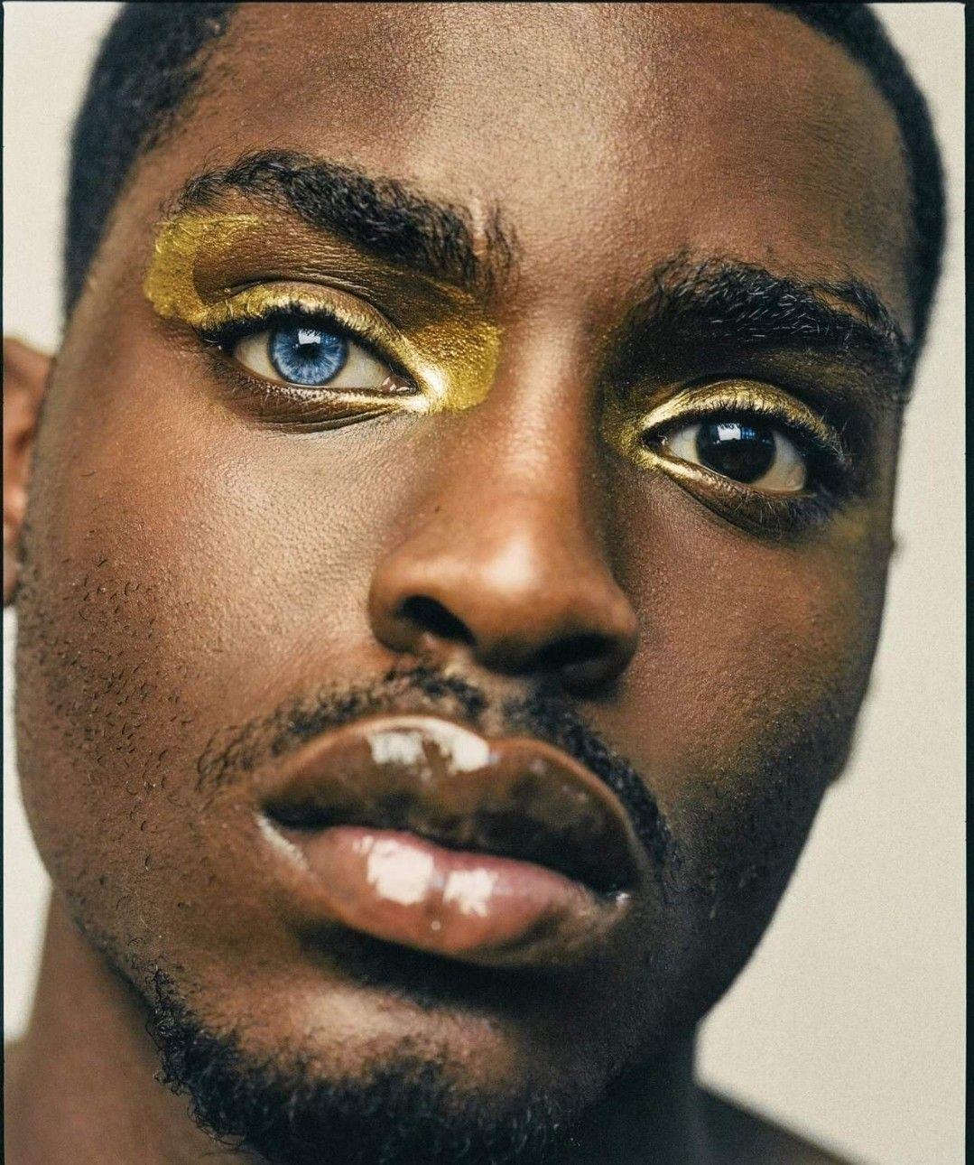 Blue Eyed Black man | Men wearing makeup, Gold makeup