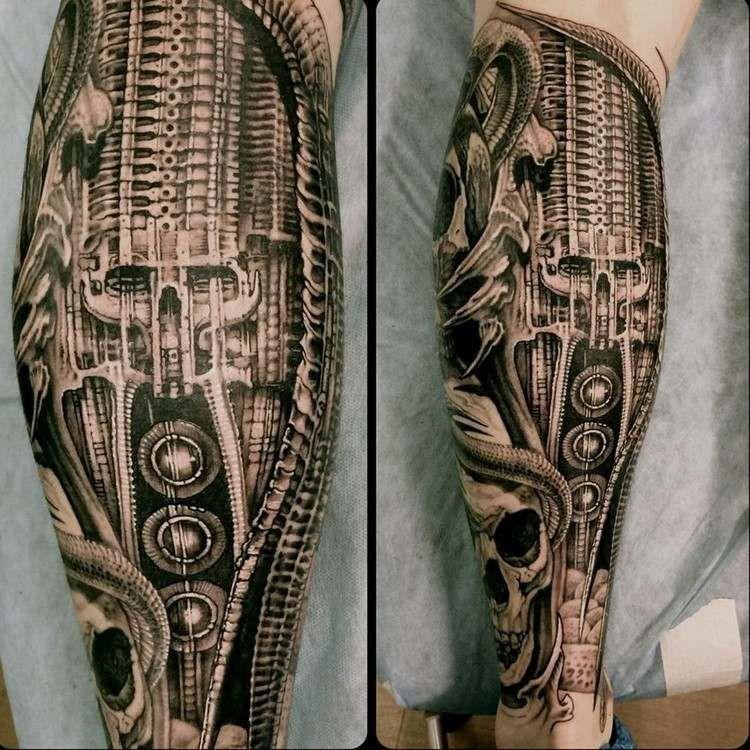 biomechanik tattoo wade stossdaempfer schaedel design. Black Bedroom Furniture Sets. Home Design Ideas