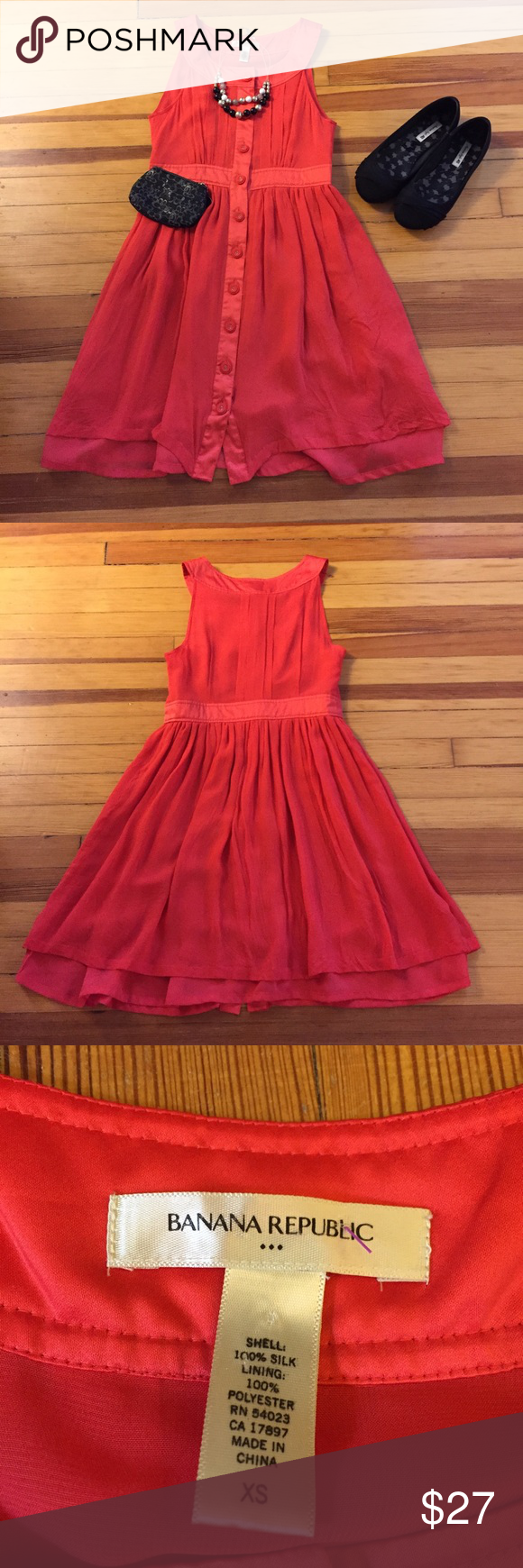 "Banana Republic red sleeveless crepe dress sz XS ▫️Banana Republic red sleeveless a-line dress sz XS ▫️crepe like material ▫️10 fully functional buttons along the center front ▫️no zipper ▫️small dirt stain on the interior lining ▫️shell = 100% silk; lining = 100% polyester ▫️bust = 31""; waist = 26""; Length = 31"" Banana Republic Dresses Midi"