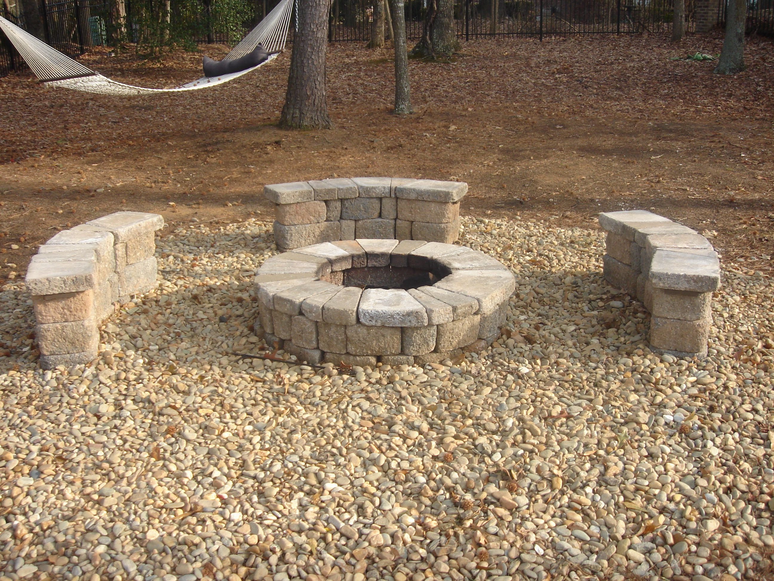 fire pit with rocks gravel landscaping