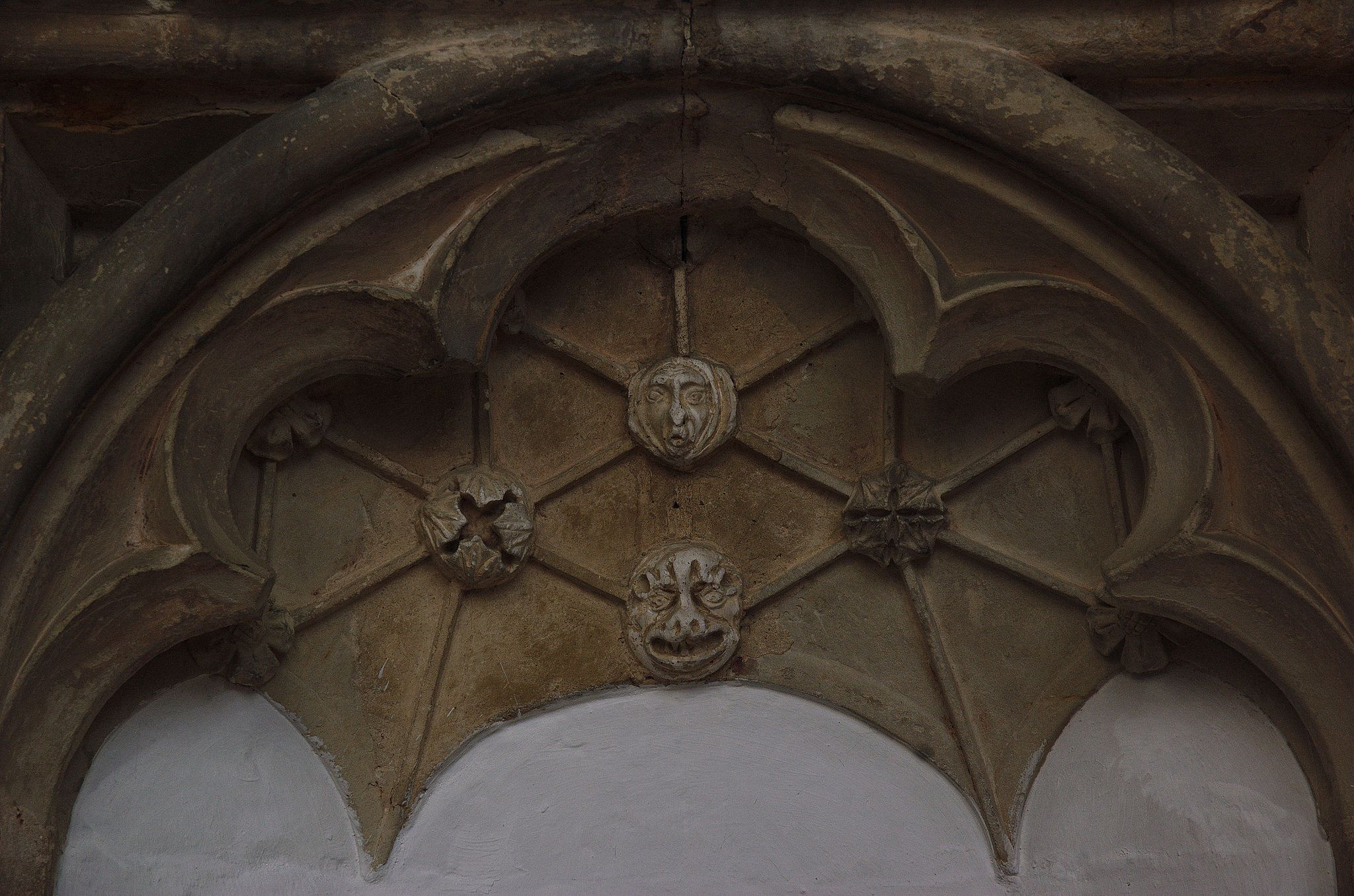 https://flic.kr/p/qswMmS | Walpole, St. Peter, Norfolk, choir, north wall, canopy | carved to look as though the ribbed part was a vault, though the distance from front to back is but a few centimeters ; note the monstrous faces at the junctions of several ribs