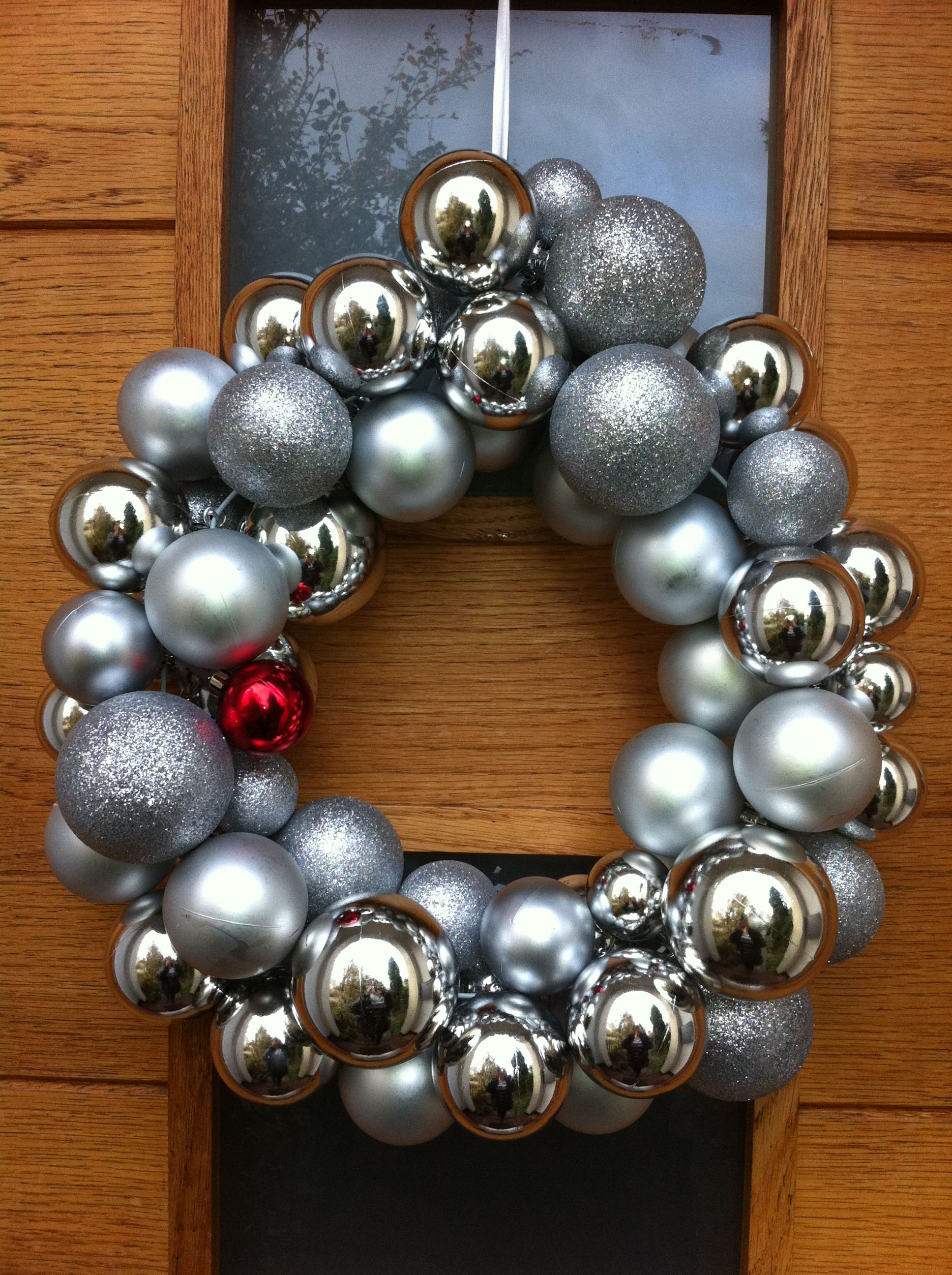 Christmas wreath. Bauble wreath. Threaded baubles on a bent wire hanger. 30 mins to make, 1 week to realise how to do it.