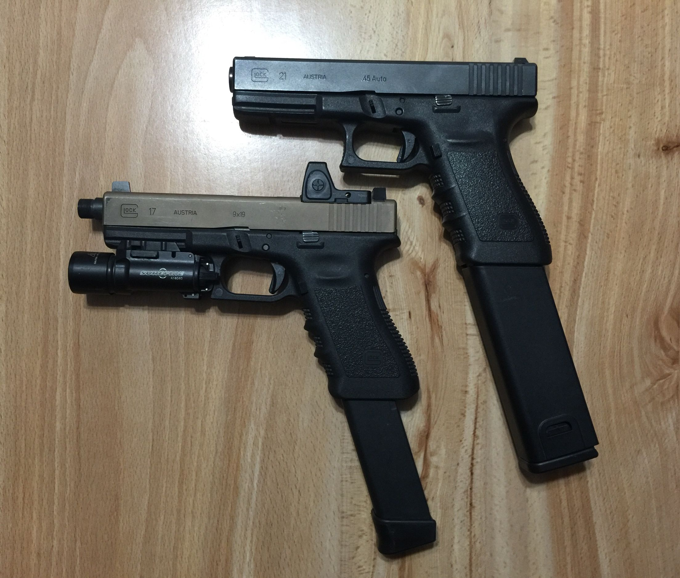 glock 21sf with kriss vector magazine extension and glock 17 with