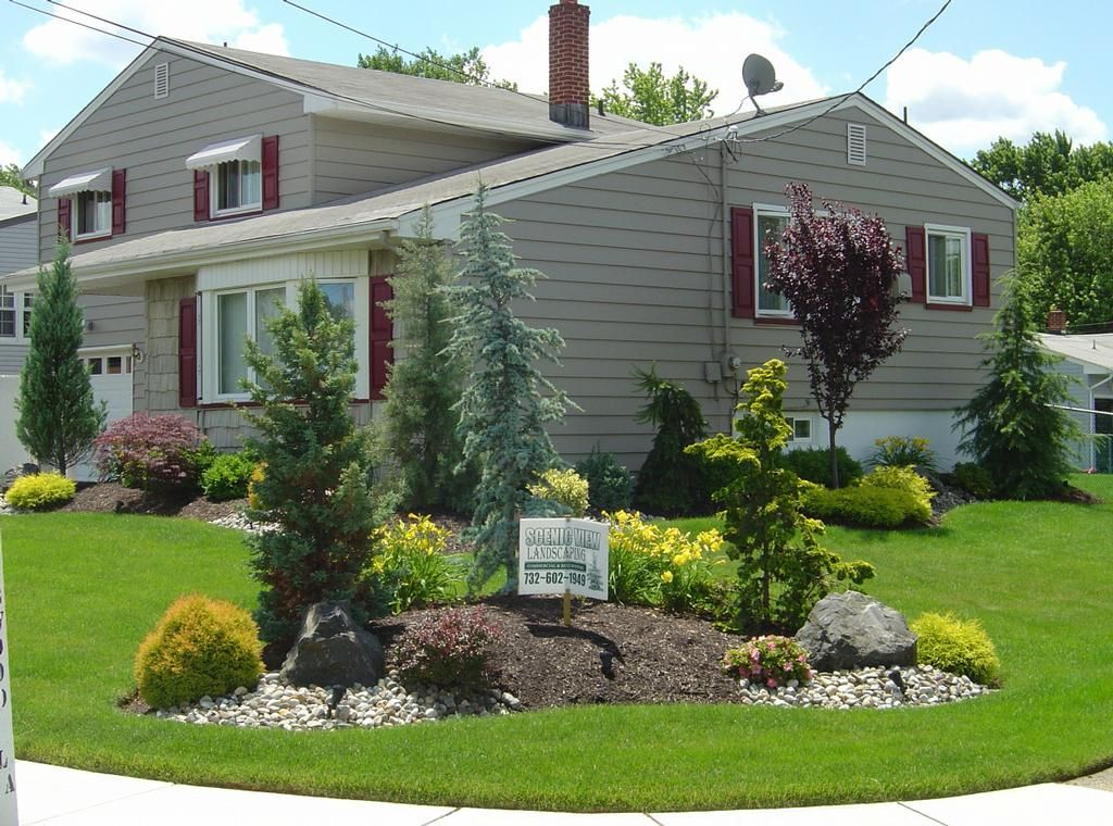 Nice And Simple Might Need A Mount Like This In My Grass Front Yard Garden Design Corner Landscaping Front Yard Landscaping Design