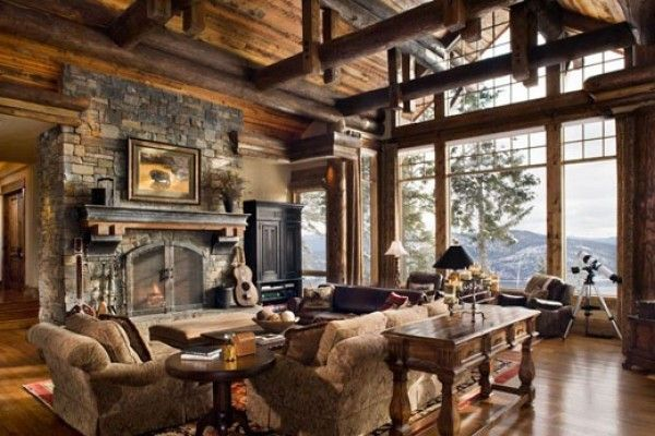Rustic Family Room With Exposed Beams Wall Of Windows.