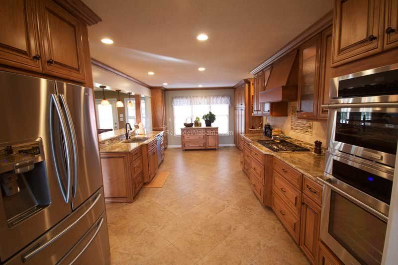 Under Cabinet Lights, Granite Counter Tops, Stainless Steel Appliances,  Custom Hood Vent