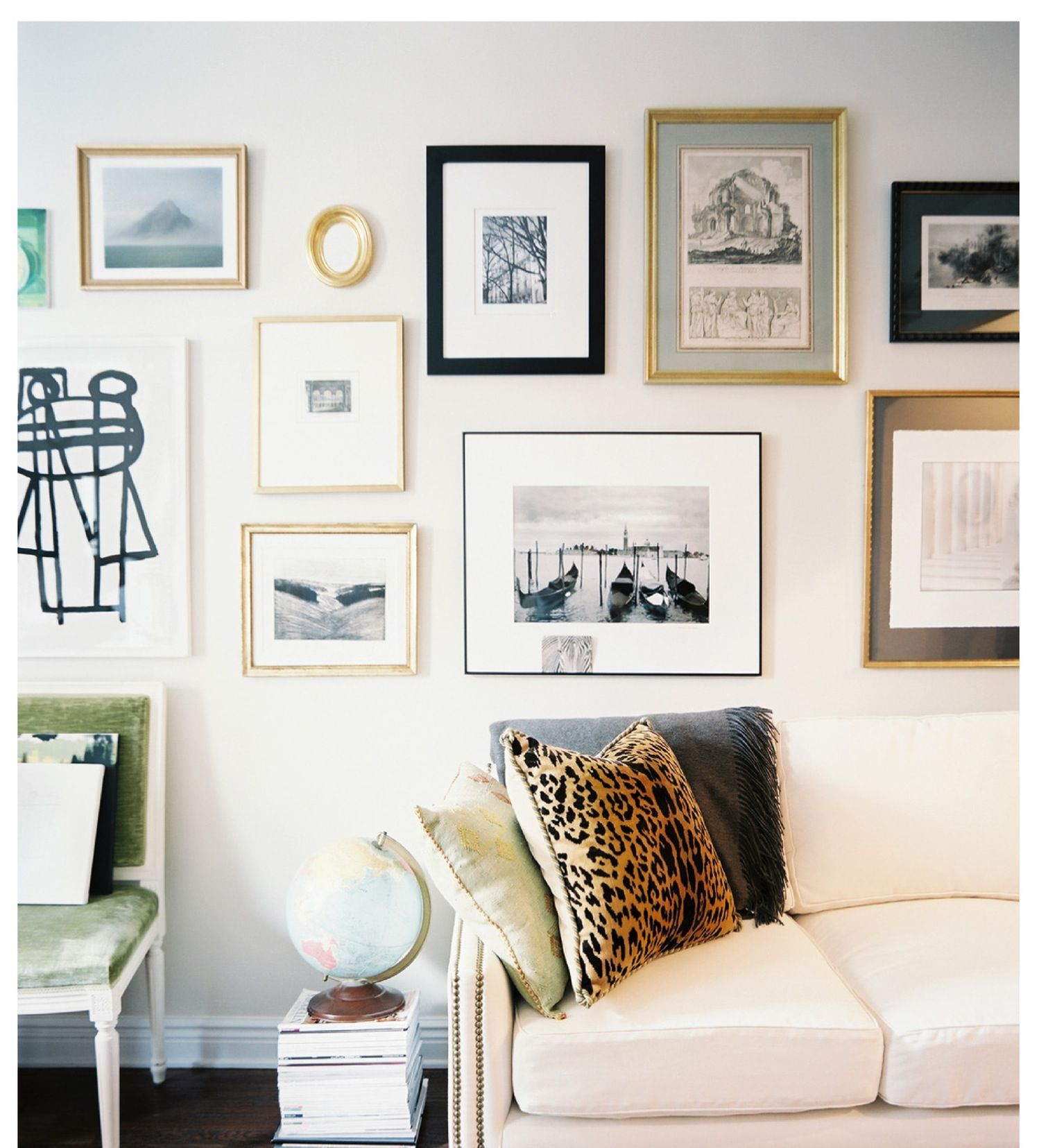 Mixing frames, matting. Love the light visual of this wall ...