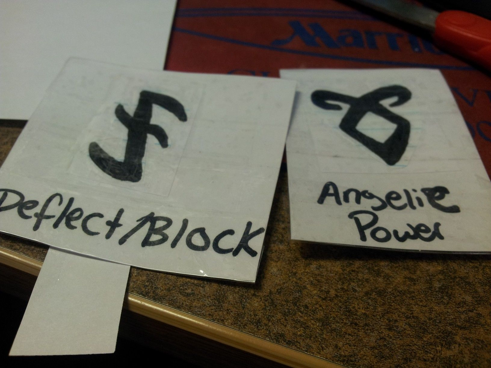 """My attempt at the only two runes I can draw.  I """"laminated"""" them with tape. Lol.  #TMIMovie"""