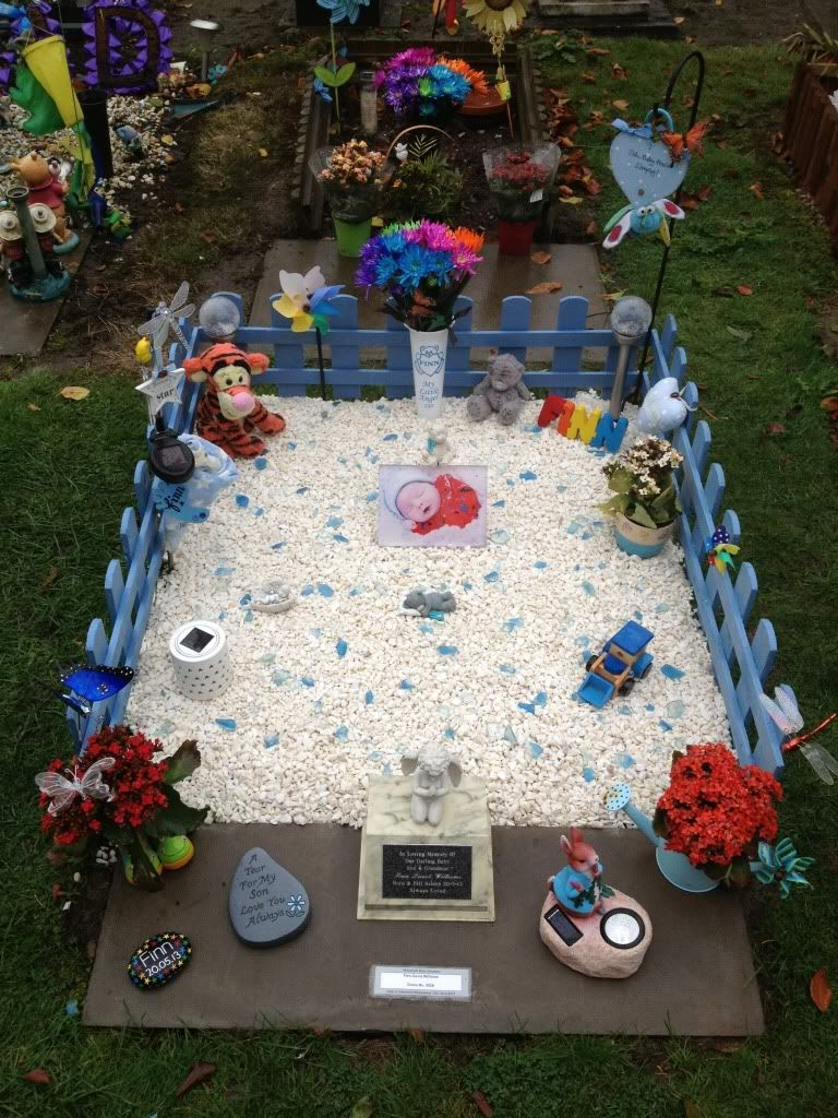 family added a sandbox to their baby u0027s grave so big brother could