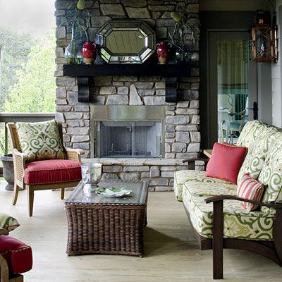 This space mirrors both the function and the layout of an interior living room. An outdoor sofa and club chairs are arranged around a central hearth.