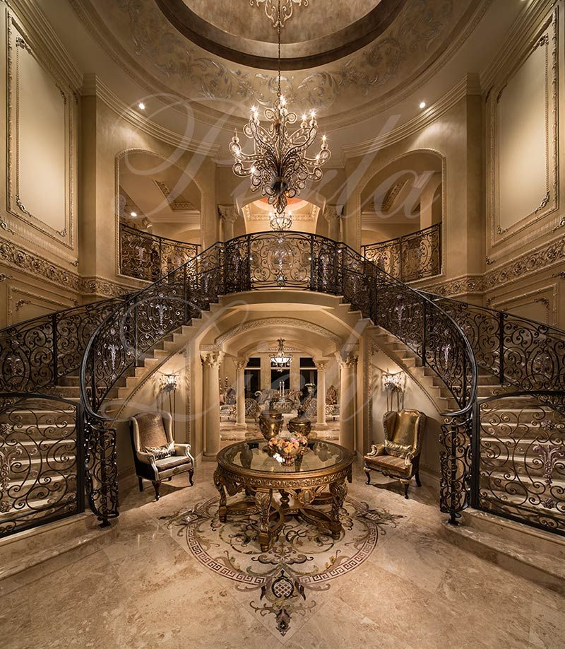 A Grand Foyer : Double grand foyer stairway wrought iron railings