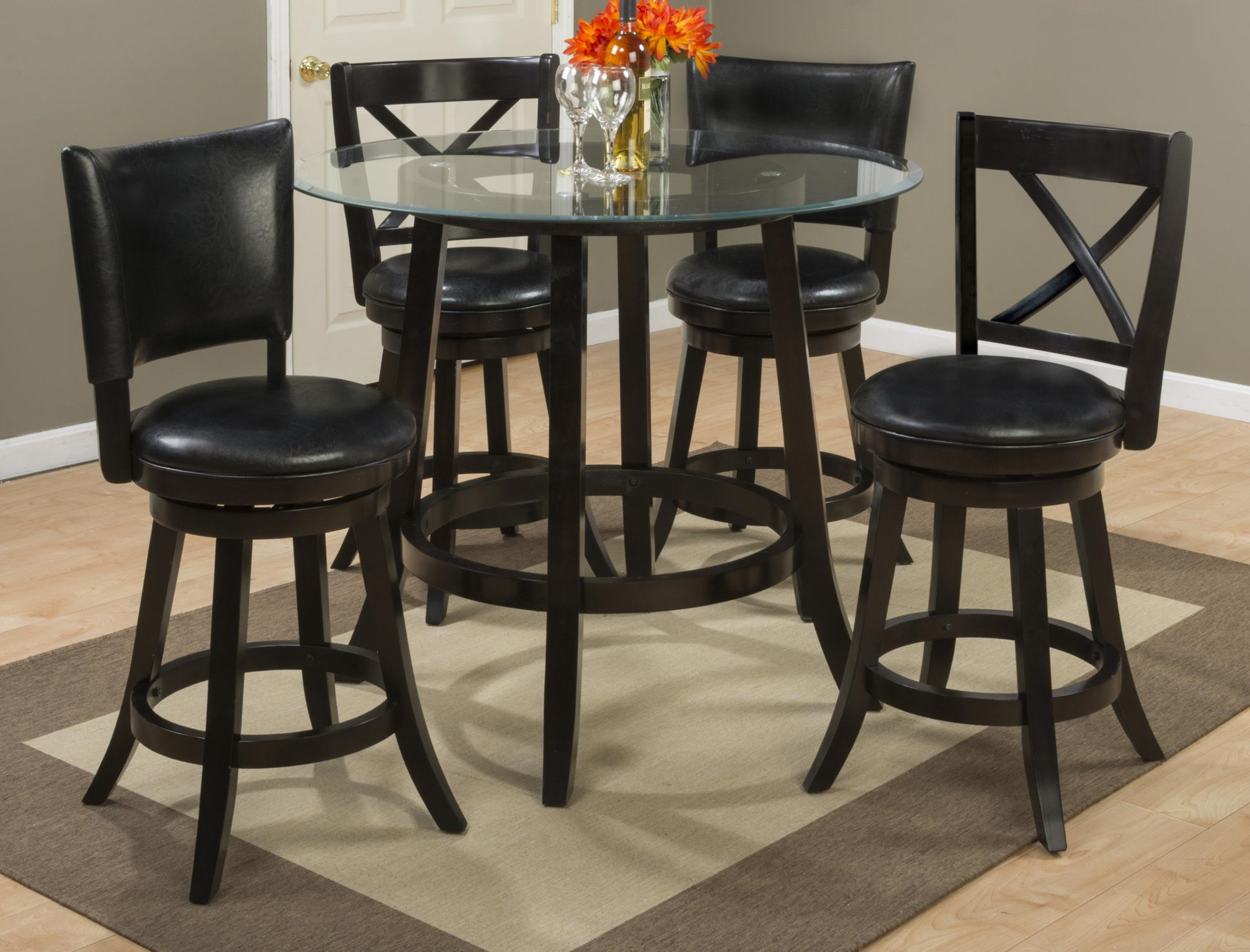 A Counter Height Glass Dining Table With Four Chairs Dining Tables