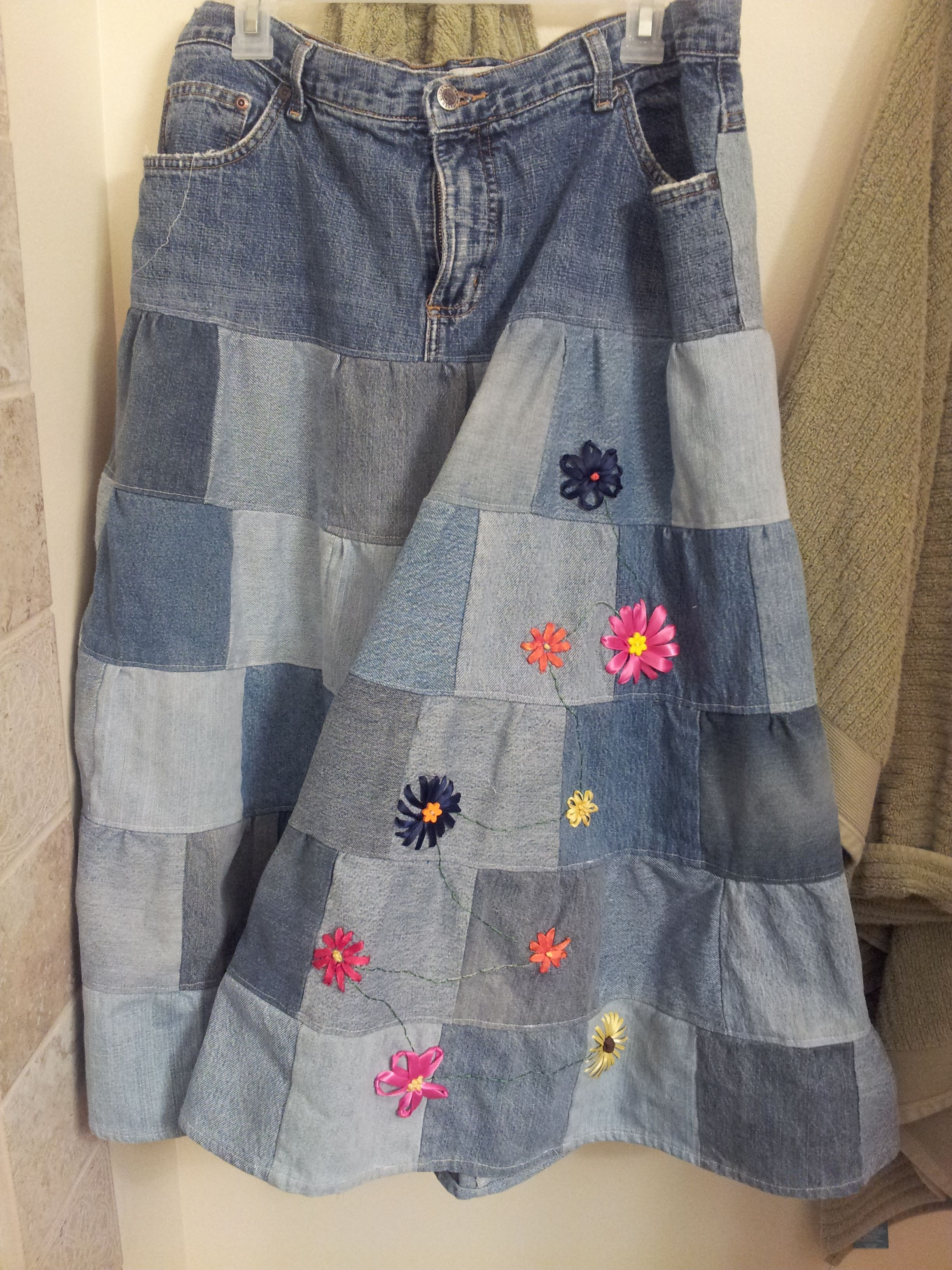 A lot of people reuse denim for quilts, but why not reuse something you wear for something to wear? The skirt is a tiered skirt essentially. I used a pair of jeans, cut out the back and filled it with a row of squares and then just added tiers until it was the desired length. Originally it had denim flowers, but I dropped them for brighter ribbon embroidered blooms.