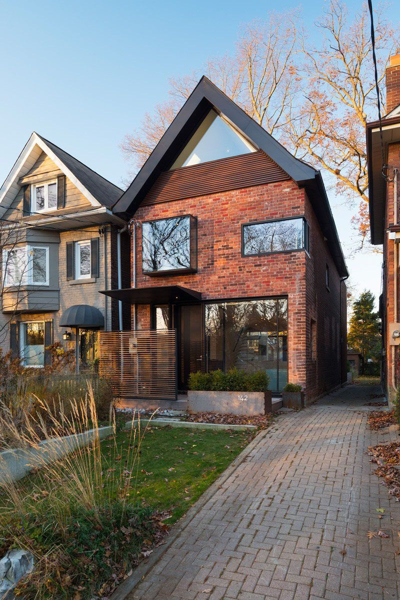This Early 1930s House In Toronto Canada Received A Contemporary Redesign Modern Brick House Toronto Houses House Exterior