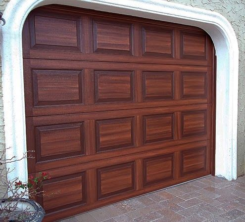 How to faux finish your garage doors to look like wood for Wood looking garage doors