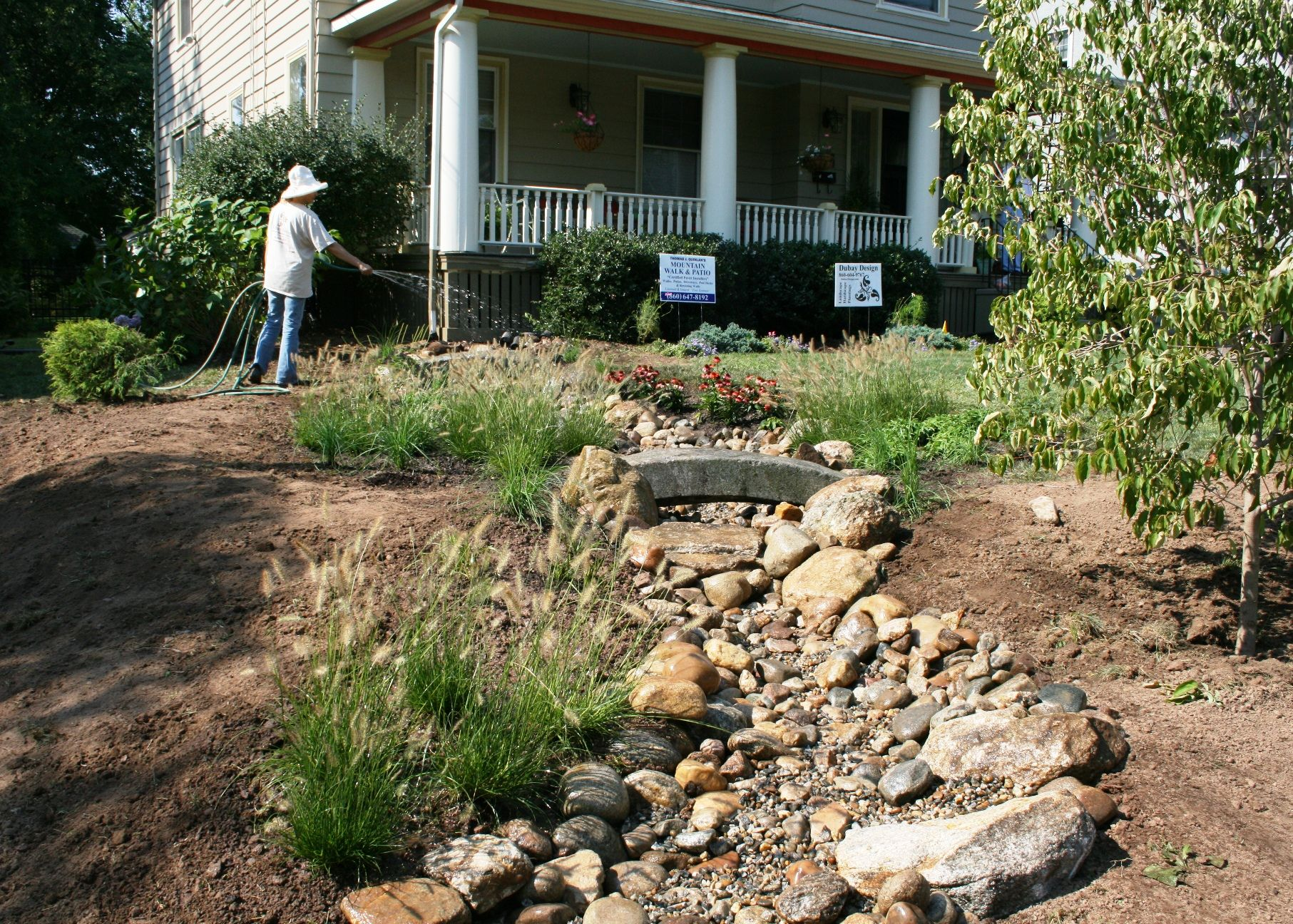 A Gorgeous New Rain Garden/bioswale. Great Idea For The Front Door Gutter