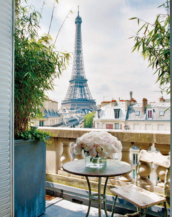 Paris apartment balcony with view of the Eiffel Tower.