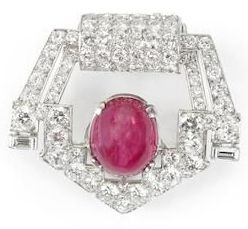 ART DECO RUBY AND DIAMOND CLIP, by Cartier, circa 1930.