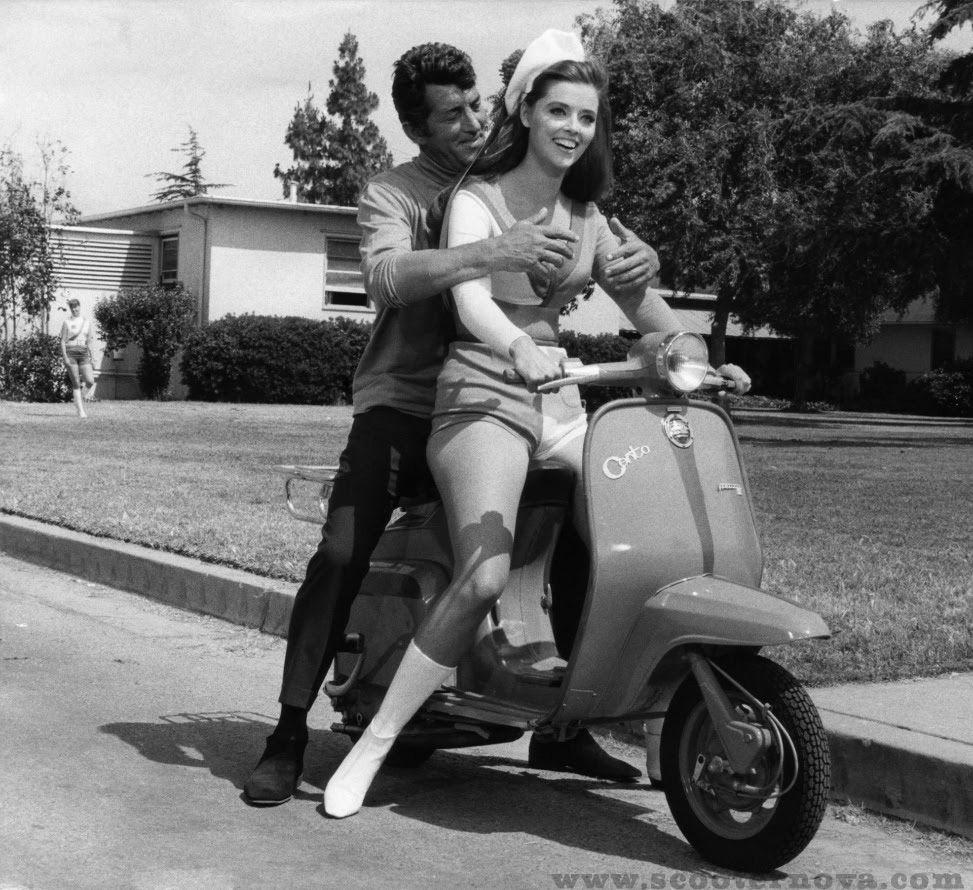 """Rat Pack Member Dean Martin Gets A Lift On A Lambretta"