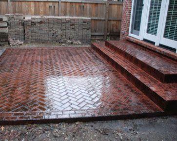 Stamped concrete patios mi patio brick herringbone idea for Brick porch designs