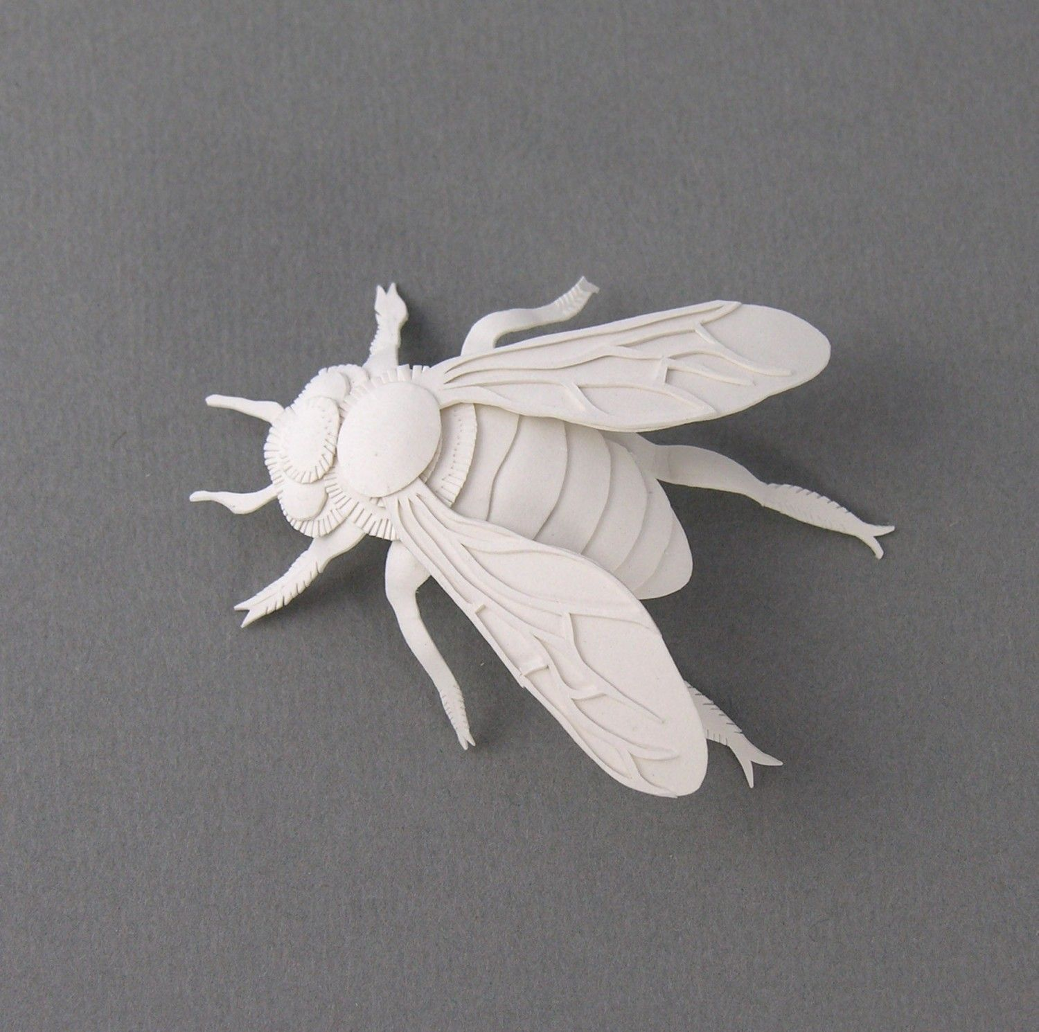 Not sure why anyone would NEED this, but it sure is cool. Bee Miniature Paper Sculpture by elsita on Etsy