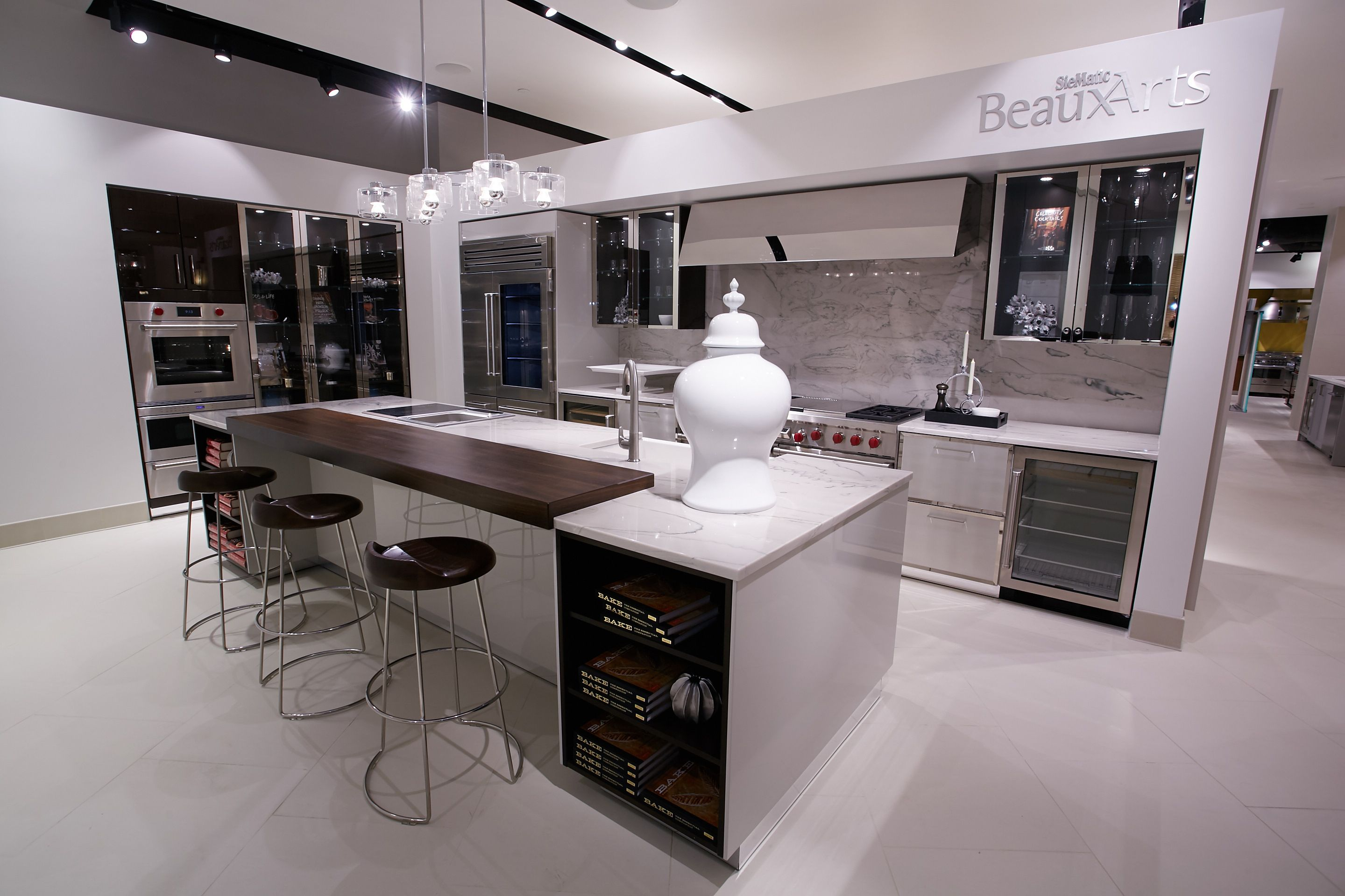 Kitchen vignette featuring Subzero Wolf built in oven and stove top ...