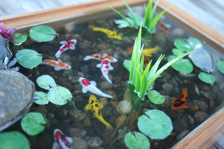 Miniature koi pond tiny faux fish in resin being koi for Miniature koi fish