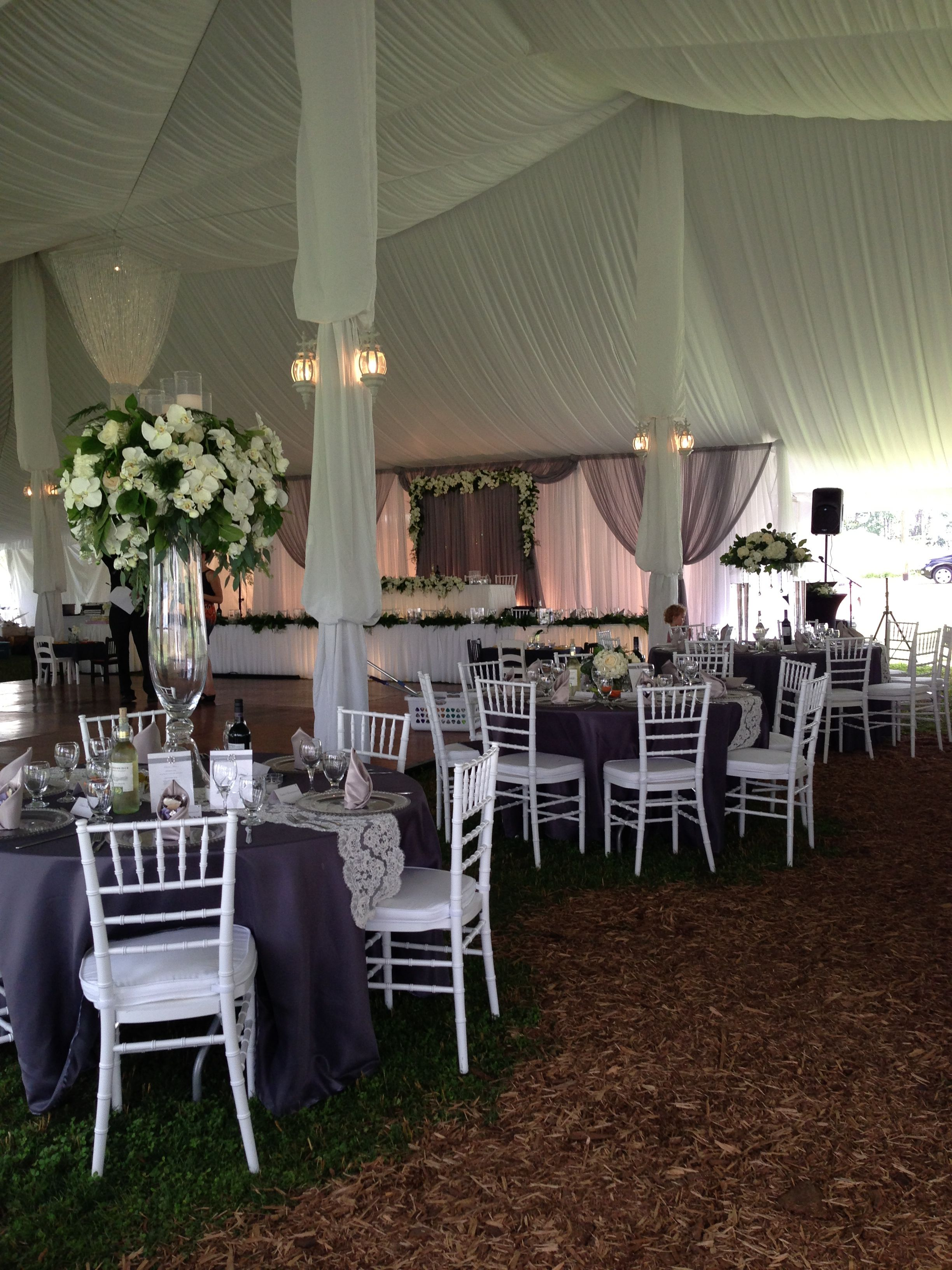 Grey and white wedding tent by Village Vines floral and Events www.villagevinesflorists.com