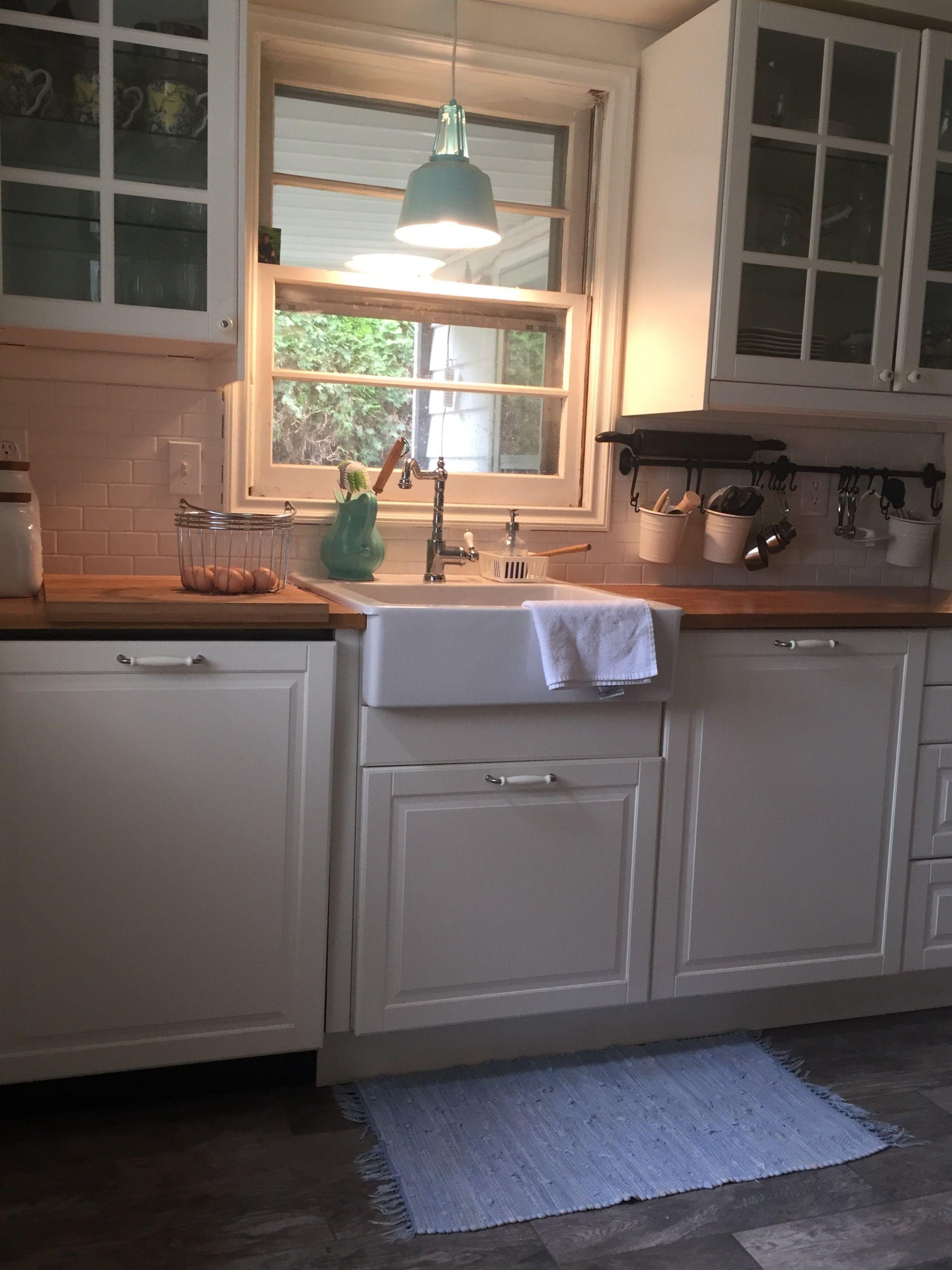 White farmhouse style kitchen with wood countertops.   Small Kitchen ...